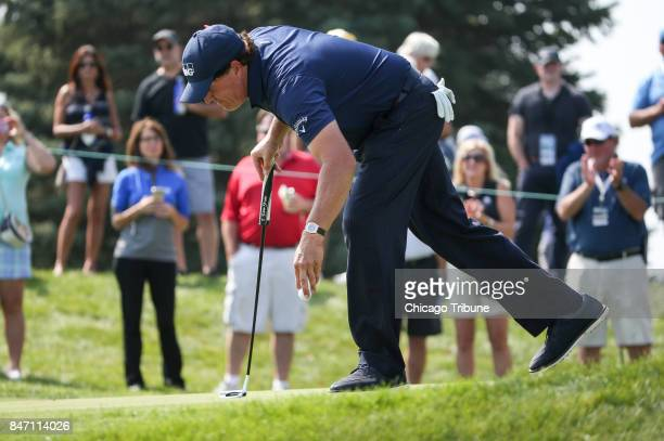 Phil Mickelson finishes putting the on the 13th hole during the first round of the BMW Championship on Thursday Sept 14 at Conway Farms Golf Club in...