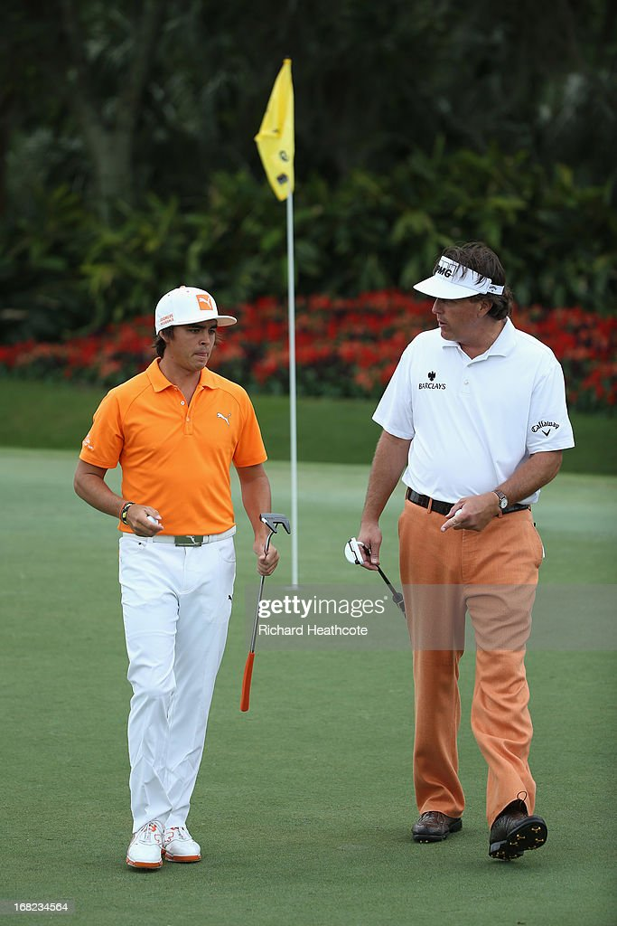 Phil Mickelson give Rickie Fowler some putting tips during a practise round for THE PLAYERS Championship at TPC Sawgrass on May 7, 2013 in Ponte Vedra Beach, Florida.