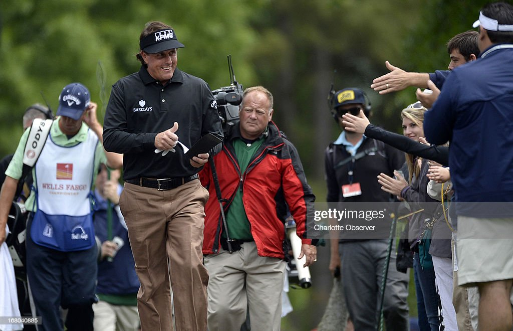 Phil Mickelson gives fans the thumbs up while approaching the fourth tee during the third round of the Wells Fargo Championship at Quail Hollow Club in Charlotte, North Carolina, Saturday, May 4, 2013.