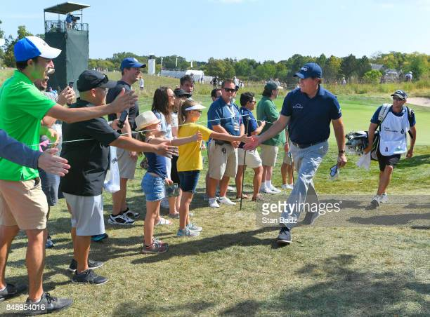 Phil Mickelson greets fans on the fourth hole during the final round of the BMW Championship at Conway Farms Golf Club on September 17 2017 in Lake...