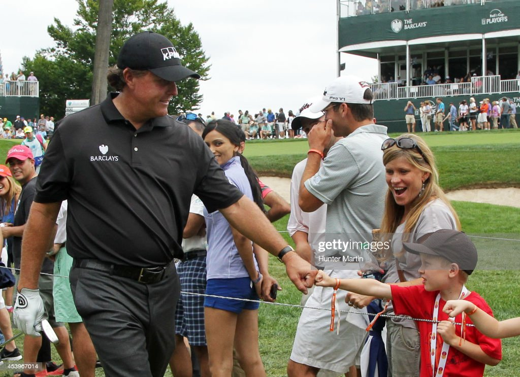 <a gi-track='captionPersonalityLinkClicked' href=/galleries/search?phrase=Phil+Mickelson&family=editorial&specificpeople=157543 ng-click='$event.stopPropagation()'>Phil Mickelson</a> greets young fans during the second round of The Barclays at The Ridgewood Country Club on August 22, 2014 in Paramus, New Jersey.