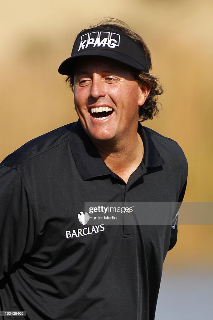 Phil Mickelson has a laugh on the 15th hole during the first round of the Waste Management Phoenix Open at TPC Scottsdale on January 31, 2013 in Scottsdale, Arizona.