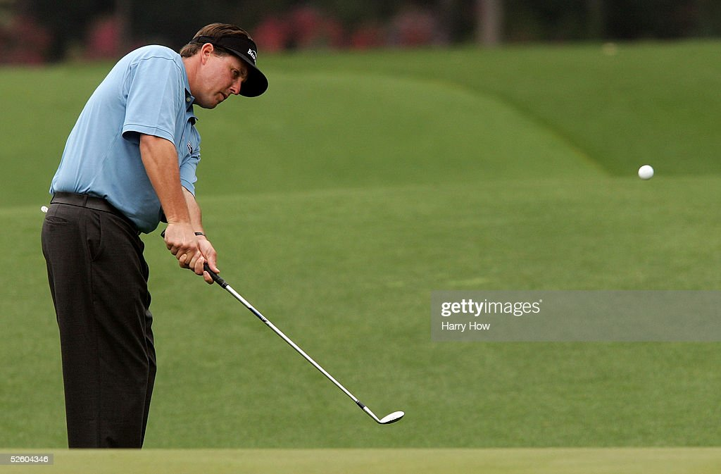 Phil Mickelson his a chip shot to the 14th green during the first round of The Masters at the Augusta National Golf Club on April 8, 2005 in Augusta, Georgia.