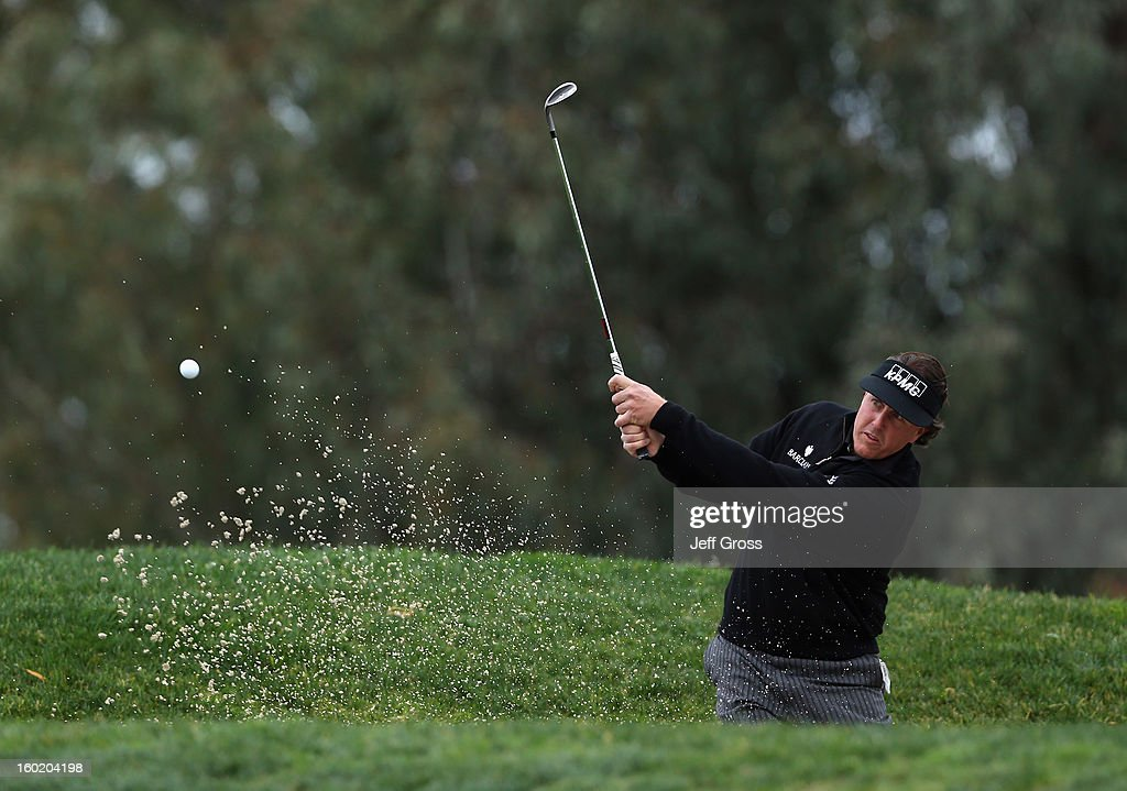 Phil Mickelson hits a bunker shot to the 11th green during the third round of the Farmers Insurance Open at at Torrey Pines South Golf Course on January 27, 2013 in La Jolla, California.