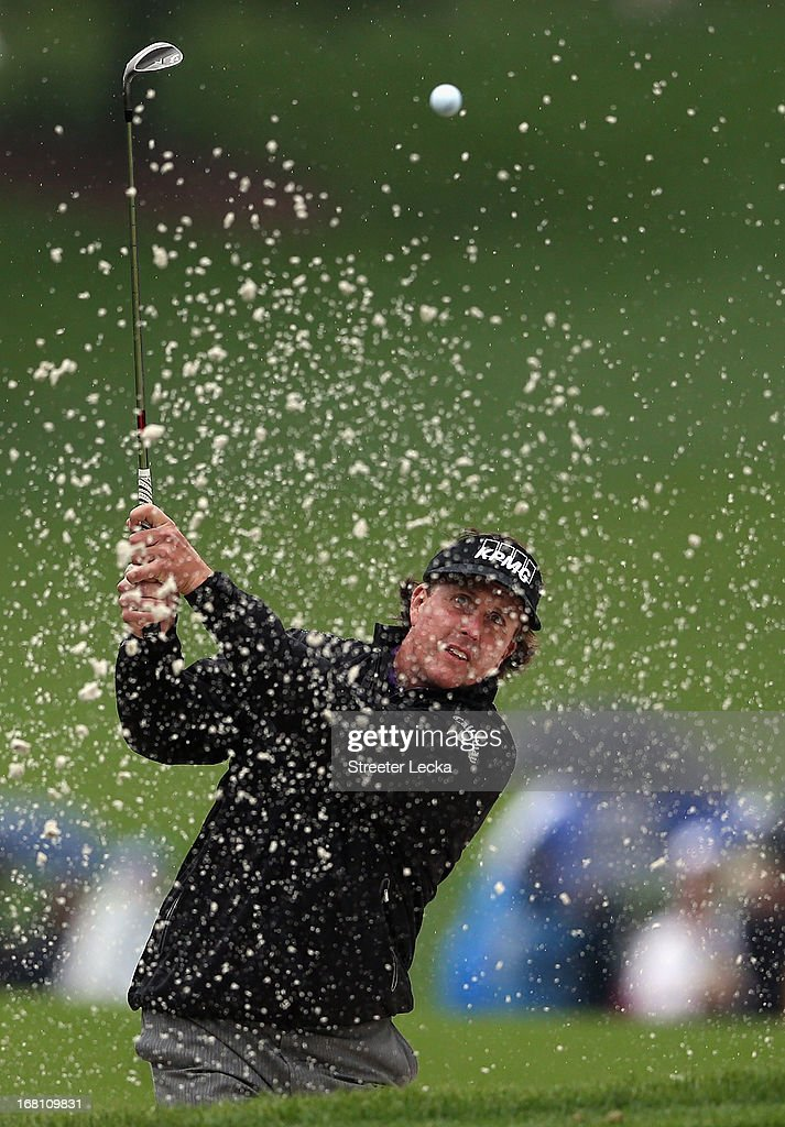 Phil Mickelson hits a shot from the sand on the 16th hole during the final round of the Wells Fargo Championship at Quail Hollow Club on May 5, 2013 in Charlotte, North Carolina.