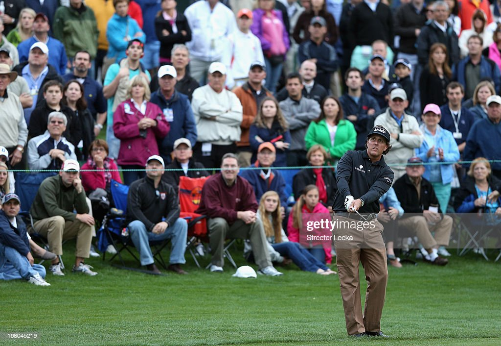 Phil Mickelson hits a shot on the 18th hole during the third round of the Wells Fargo Championship at Quail Hollow Club on May 4, 2013 in Charlotte, North Carolina.