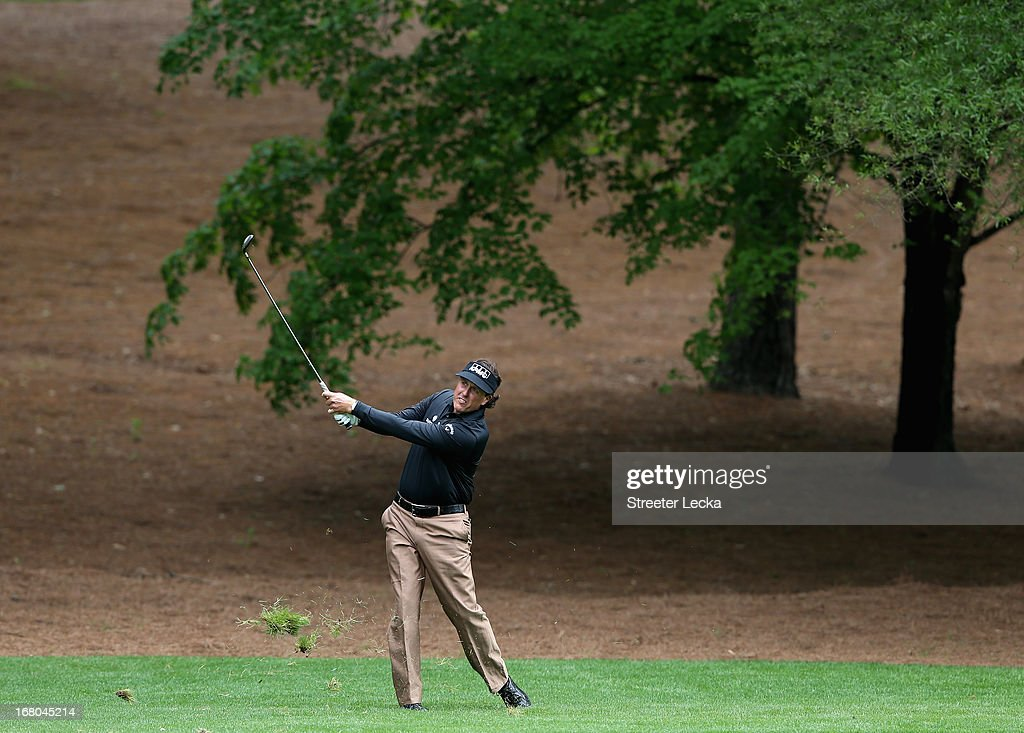 Phil Mickelson hits a shot on the 3rd hole during the third round of the Wells Fargo Championship at Quail Hollow Club on May 4, 2013 in Charlotte, North Carolina.