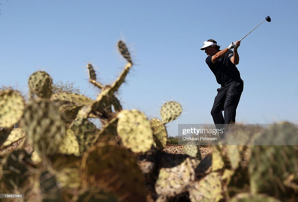 <a gi-track='captionPersonalityLinkClicked' href=/galleries/search?phrase=Phil+Mickelson&family=editorial&specificpeople=157543 ng-click='$event.stopPropagation()'>Phil Mickelson</a> hits a tee shot on the 11th hole during the final round of the Waste Management Phoenix Open at TPC Scottsdale on February 5, 2012 in Scottsdale, Arizona.