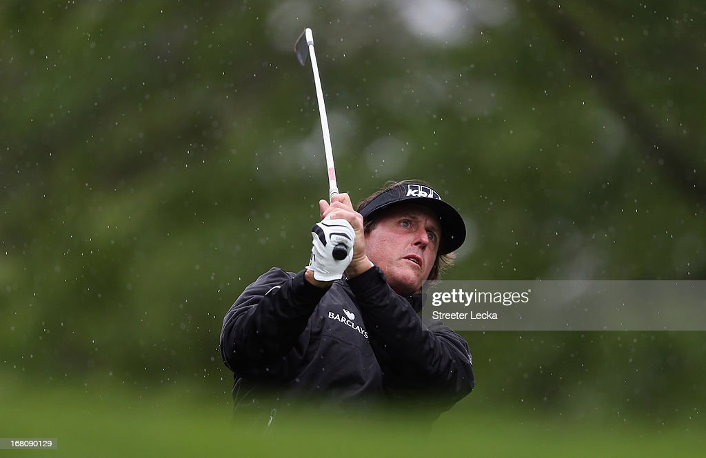 Phil Mickelson hits a tee shot on the 6th hole during the final round of the Wells Fargo Championship at Quail Hollow Club on May 5, 2013 in Charlotte, North Carolina.