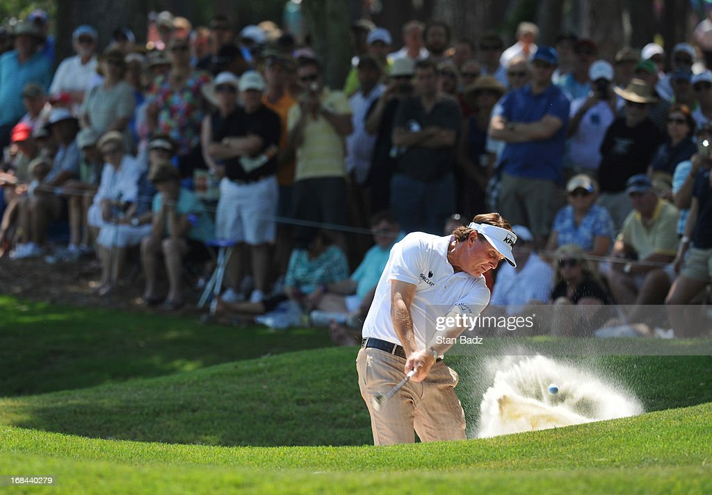 Phil Mickelson hits from a bunker on the eighth hole during the first round of THE PLAYERS Championship on THE PLAYERS Stadium Course at TPC Sawgrass on May 9, 2013 in Ponte Vedra Beach, Florida.