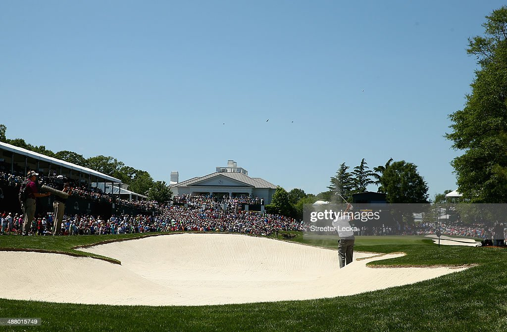 Phil Mickelson hits from the sand on the 18th hole during the third round of the Wells Fargo Championship at Quail Hollow Club on May 3 2014 in...