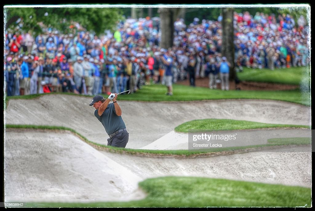 <a gi-track='captionPersonalityLinkClicked' href=/galleries/search?phrase=Phil+Mickelson&family=editorial&specificpeople=157543 ng-click='$event.stopPropagation()'>Phil Mickelson</a> hits from the sand on the seventh hole during the second round of the 2016 Wells Fargo Championship at Quail Hollow Club on May 6, 2016 in Charlotte, North Carolina.