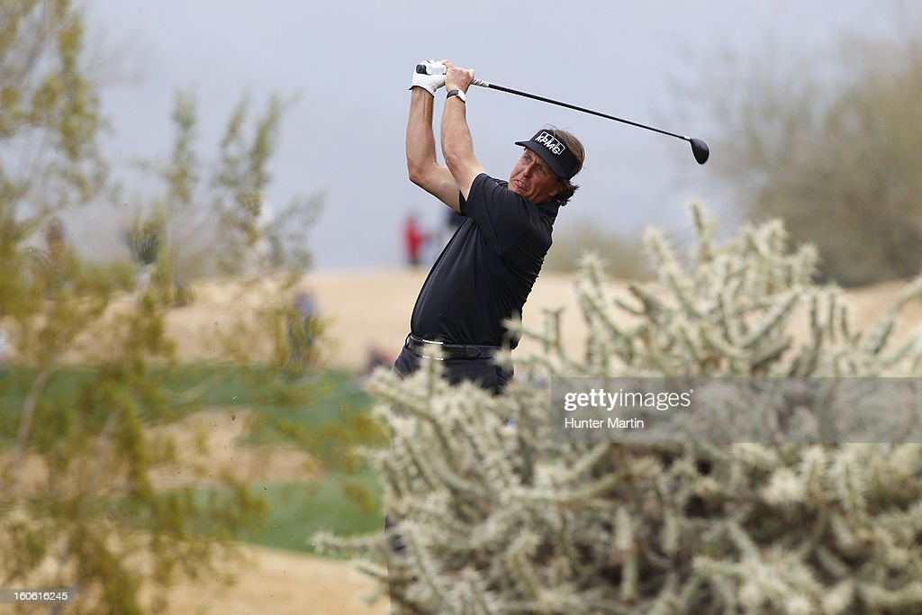 Phil Mickelson hits his second shot on the 13th hole during the final round of the Waste Management Phoenix Open at TPC Scottsdale on February 3, 2013 in Scottsdale, Arizona.