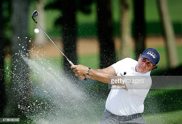 Phil Mickelson hits his shot out of the 15th hole bunker during round three at the Wells Fargo Championship at Quail Hollow Club on May 16 2015 in...