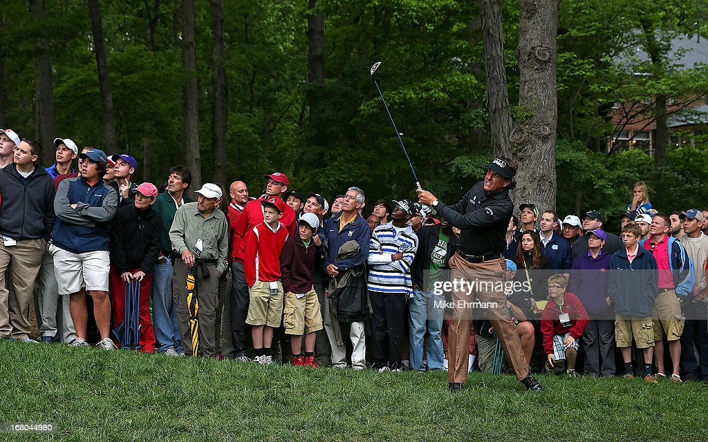 Phil Mickelson hits his shot out of the gallery on the 15th hole during the third round of the Wells Fargo Championship at Quail Hollow Club on May 4, 2013 in Charlotte, North Carolina.