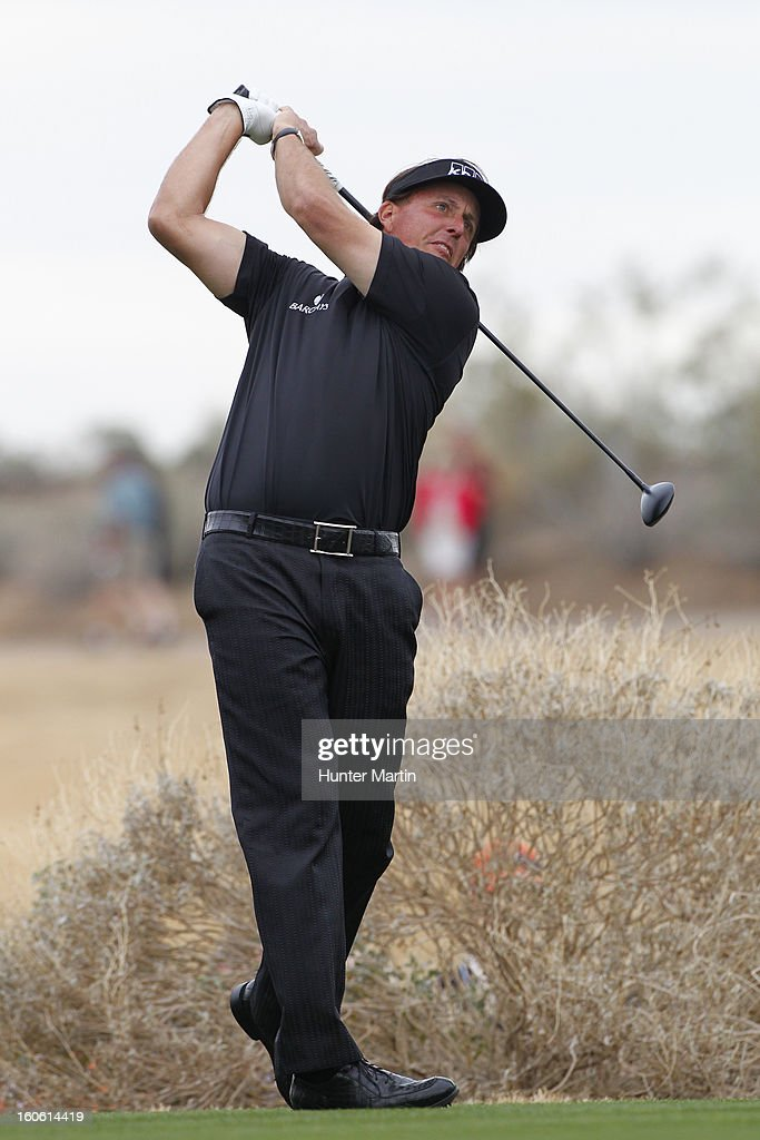 Phil Mickelson hits his tee shot on the 13th hole during the final round of the Waste Management Phoenix Open at TPC Scottsdale on February 3, 2013 in Scottsdale, Arizona.