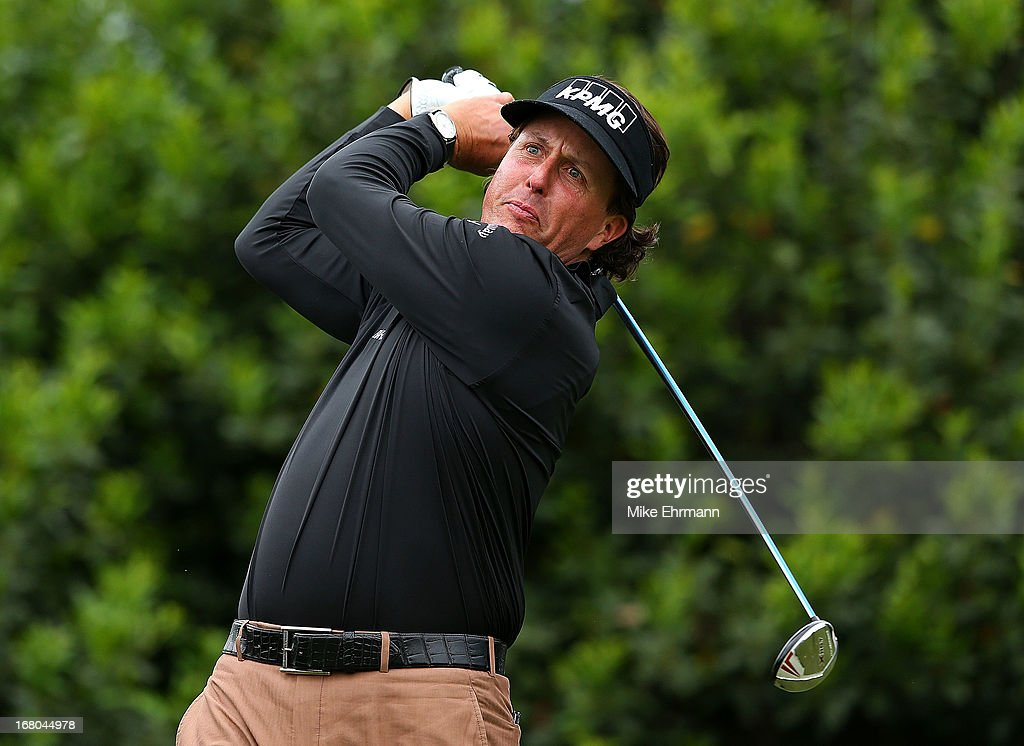 Phil Mickelson hits his tee shot on the 15th hole during the third round of the Wells Fargo Championship at Quail Hollow Club on May 4, 2013 in Charlotte, North Carolina.