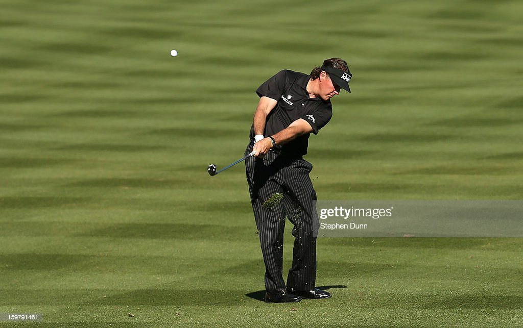 Phil Mickelson hits his third shot on the 14th hole during the final round of the Humana Challenge In Partnership With The Clinton Foundation on the Palmer Private Course at PGA West on January 20, 2013 in La Quinta, California.
