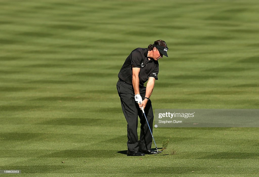 <a gi-track='captionPersonalityLinkClicked' href=/galleries/search?phrase=Phil+Mickelson&family=editorial&specificpeople=157543 ng-click='$event.stopPropagation()'>Phil Mickelson</a> hits his third shot on the 14th hole during the final round of the Humana Challenge In Partnership With The Clinton Foundation on the Palmer Private Course at PGA West on January 20, 2013 in La Quinta, California.