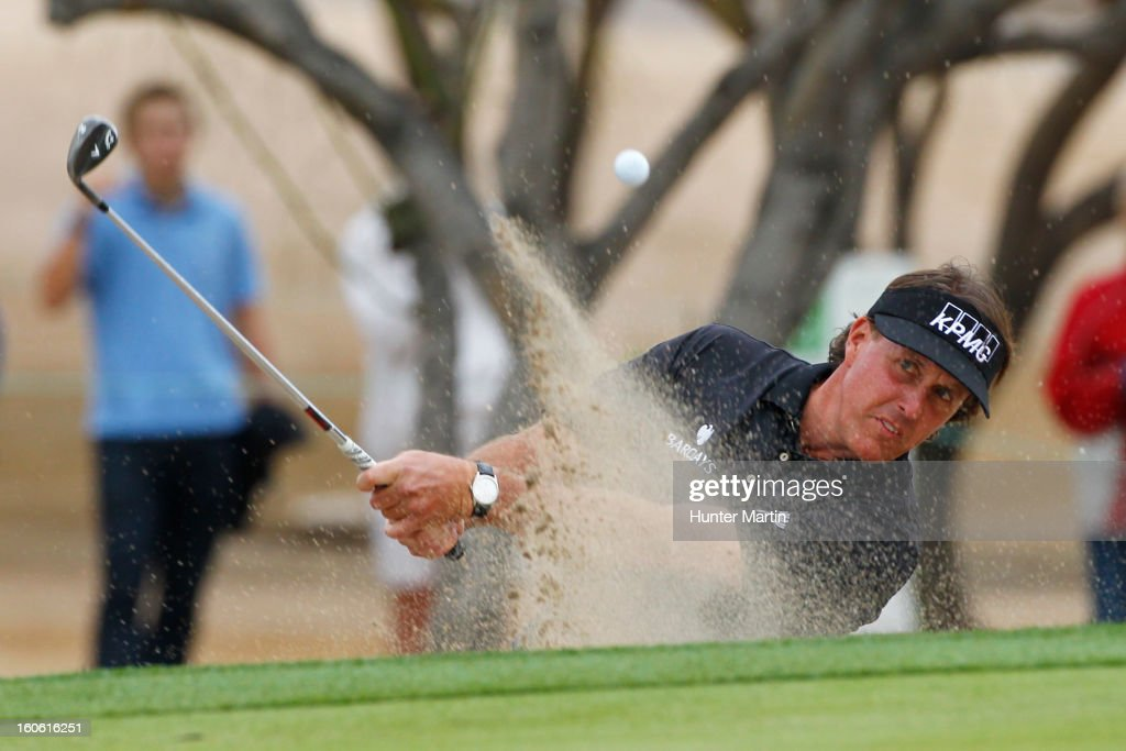 Phil Mickelson hits his third shot on the 14th hole during the final round of the Waste Management Phoenix Open at TPC Scottsdale on February 3, 2013 in Scottsdale, Arizona.
