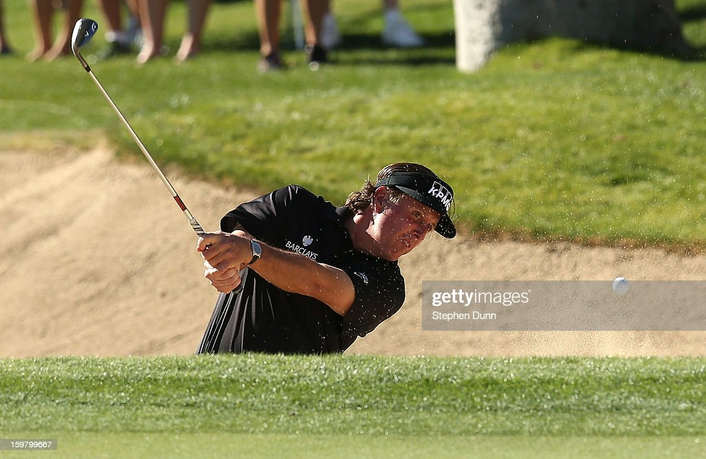 Phil Mickelson hits out of a bunker on the 12th hole during the final round of the Humana Challenge In Partnership With The Clinton Foundation on the Palmer Private Course at PGA West on January 20, 2013 in La Quinta, California.