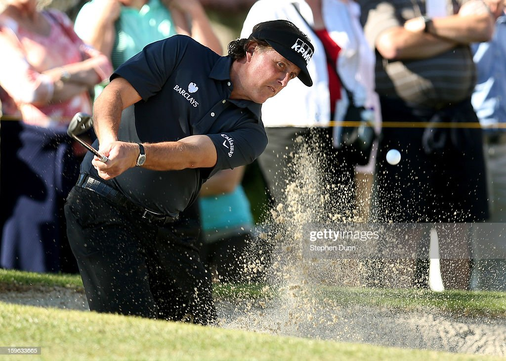 Phil Mickelson hits out of a bunker on the sixth hole during the first round of the Humana Challenge in partnership with the Clinton Foundation at La Quinta Country Club on January 17, 2013 in La Quinta, California.