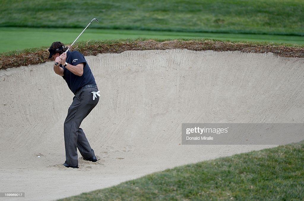 Phil Mickelson hits out of the bunker during the First Round at the Farmers Insurance Open at Torrey Pines Golf Course on January 24, 2013 in La Jolla, California.