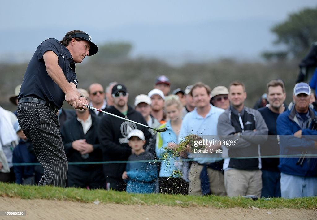 Phil Mickelson hits towards the green during the First Round at the Farmers Insurance Open at Torrey Pines Golf Course on January 24, 2013 in La Jolla, California.