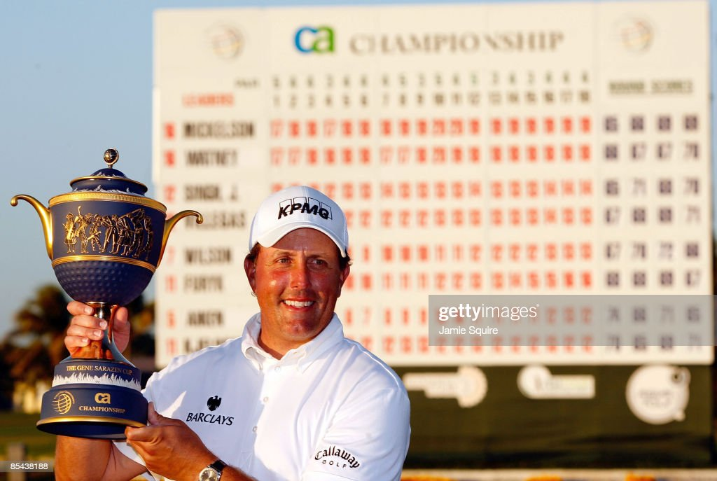 Phil Mickelson hoists the trophy after winning the World Golf ChampionshipsCA Championship on March 15 2009 at the Doral Golf Resort and Spa in Doral...