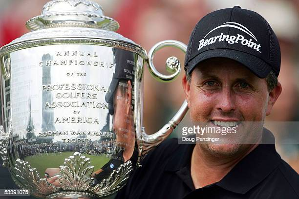 Phil Mickelson holds up the Wanamaker trophy after winning the 2005 PGA Championship with a 4uner par 276 on August 15 2005 in Springfield New Jersey