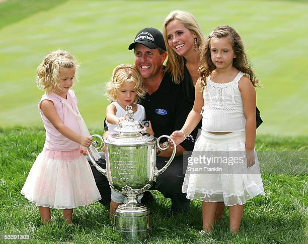 Phil Mickelson is surrounded by his wife Amy daughters Sophia Evan and Amanda after winning the 2005 PGA Championship with a 4under par 276 on August...