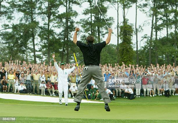 Phil Mickelson jumps in the air after making birdie on the 18th hole to win the Masters by one shot during the final round of the Masters at the...