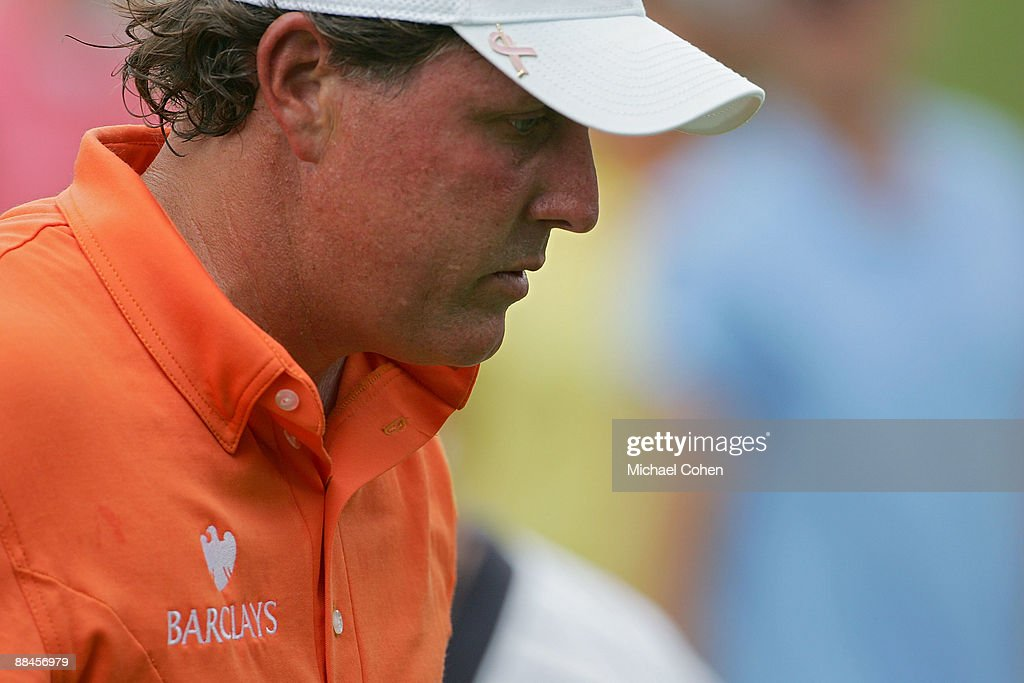 Phil Mickelson leaves the 13th green after making a bogey during the second round of the St Jude Classic at TPC Southwind held on June 12 2009 in...