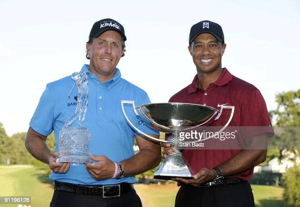 Phil Mickelson left wins THE TOUR Championship and Tiger Woods right wins the FedExCup after the final round of THE TOUR Championship presented by...