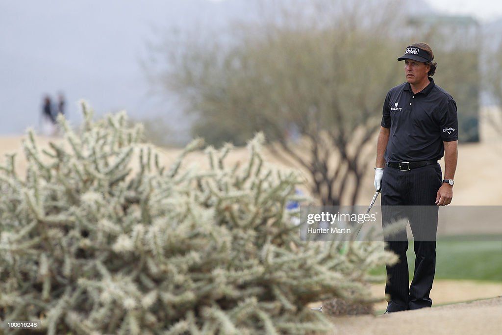 Phil Mickelson lines up his shot on the 13th hole during the final round of the Waste Management Phoenix Open at TPC Scottsdale on February 3, 2013 in Scottsdale, Arizona.