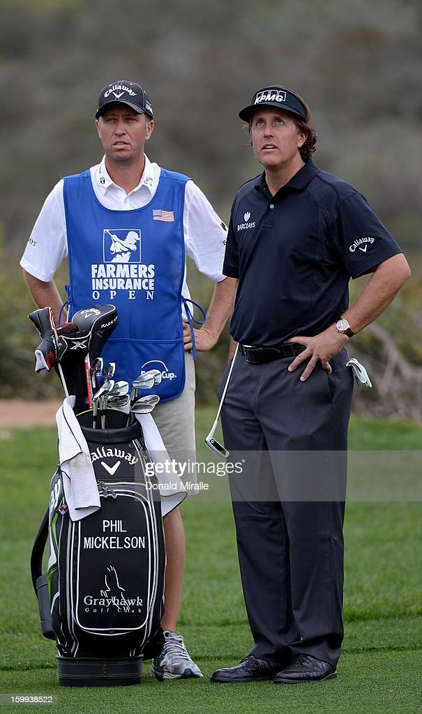 Phil Mickelson looks on the fairway with caddie Jim Mackay during the Pro-Am at the Farmers Insurance Open at Torrey Pines South Golf Course on January 23, 2013 in La Jolla, California.