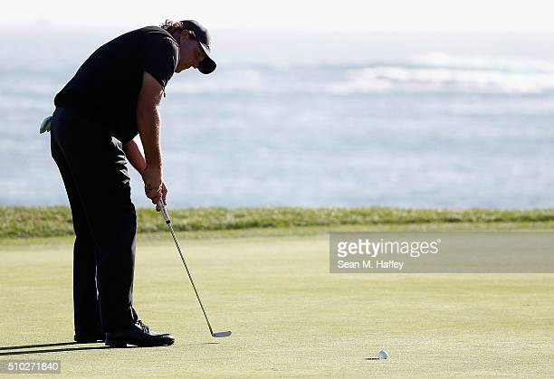 Phil Mickelson misses a birdie putt on the 18th green that would have forced a playoff with Vaughn Taylor during the final round of the ATT Pebble...