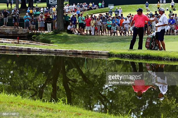 Phil Mickelson of the United States and caddie Jim 'Bones' Mackay on the 18th hole during the first round of the 2016 PGA Championship at Baltusrol...