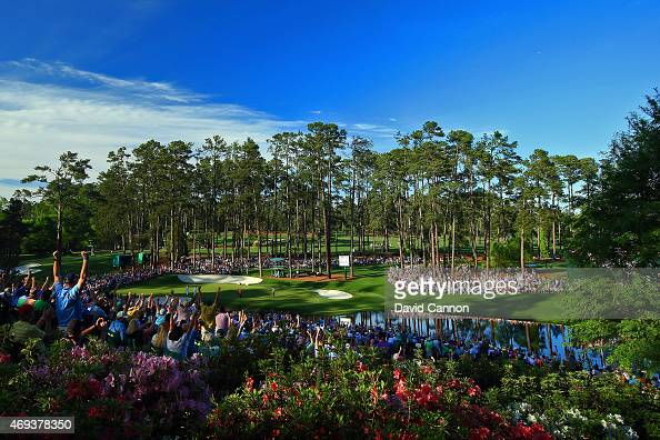 Phil Mickelson of the United States celebrates a birdie putt on the 16th green during the third round of the 2015 Masters Tournament at Augusta...
