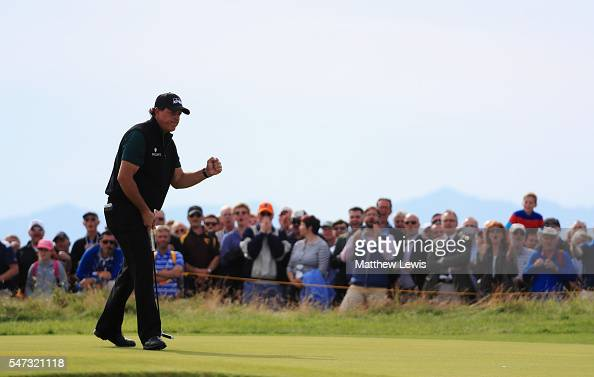 Phil Mickelson of the United States celebrates a birdie putt on the the 17th green during the first round on day one of the 145th Open Championship...