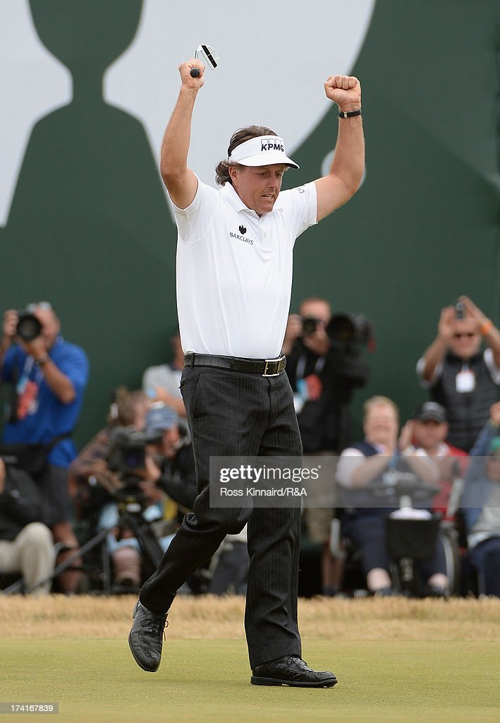 Phil Mickelson of the United States celebrates holing a birdie putt on the 18th green during the final round of the 142nd Open Championship at...