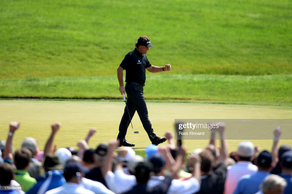 Phil Mickelson of the United States celebrates making a putt for birdie on the ninth hole during Round One of the 113th US Open at Merion Golf Club...