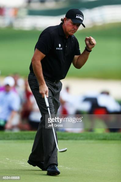 Phil Mickelson of the United States celebrates making a putt for birdie on the first hole during the final round of the 96th PGA Championship at...