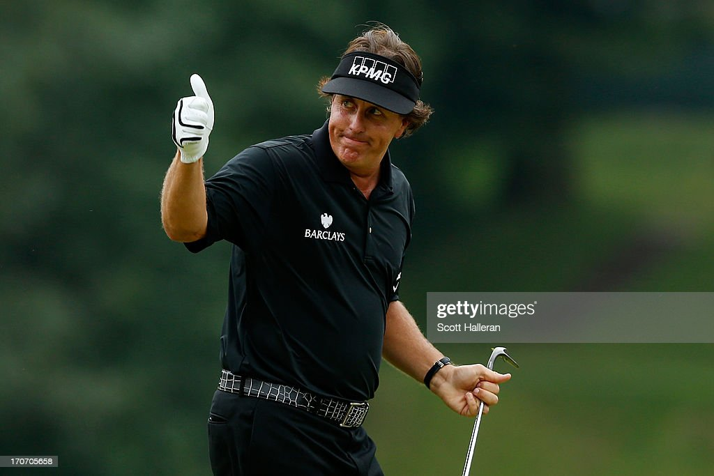 Phil Mickelson of the United States celebrates making a shot for eagle on the tenth hole during the final round of the 113th US Open at Merion Golf...