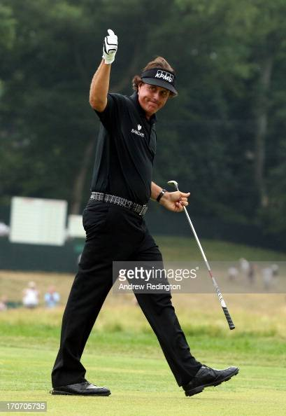Phil Mickelson of the United States celebrates making a shot for eagle on the tenth hole par 4 during the final round of the 113th US Open at Merion...