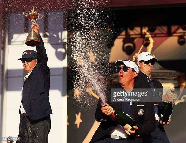 Phil Mickelson of the United States celebrates with captain Davis Love III during the closing ceremony of the 2016 Ryder Cup at Hazeltine National...