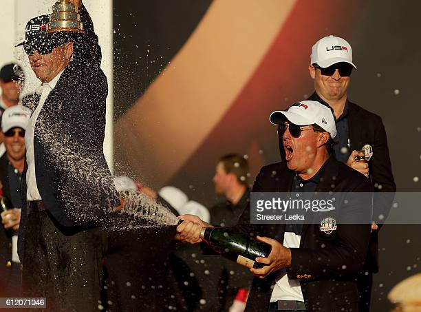 Phil Mickelson of the United States celebrates with champagne after winning the Ryder Cup during the closing ceremony of the 2016 Ryder Cup at...