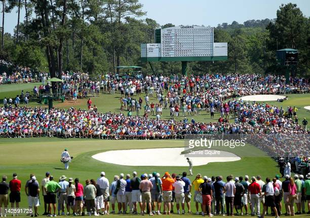 Phil Mickelson of the United States chips to the second green during the final round of the 2012 Masters Tournament at Augusta National Golf Club on...