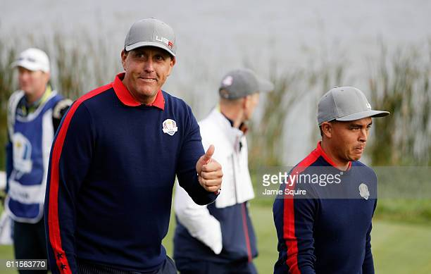 Phil Mickelson of the United States gestures with Rickie Fowler on the seventh hole during morning foursome matches of the 2016 Ryder Cup at...