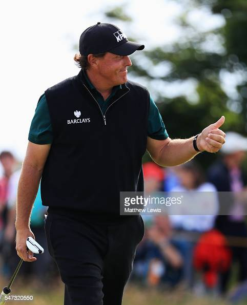 Phil Mickelson of the United States gives a thumbs up after putting on the 16th during the first round on day one of the 145th Open Championship at...